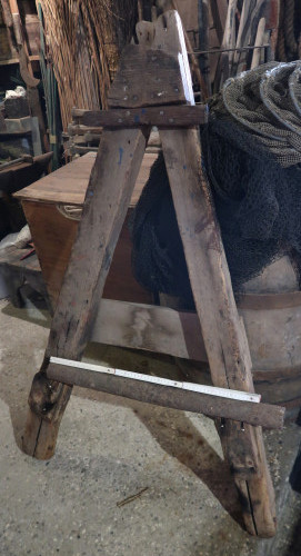 A-shaped wooden easel or fixed stand, called